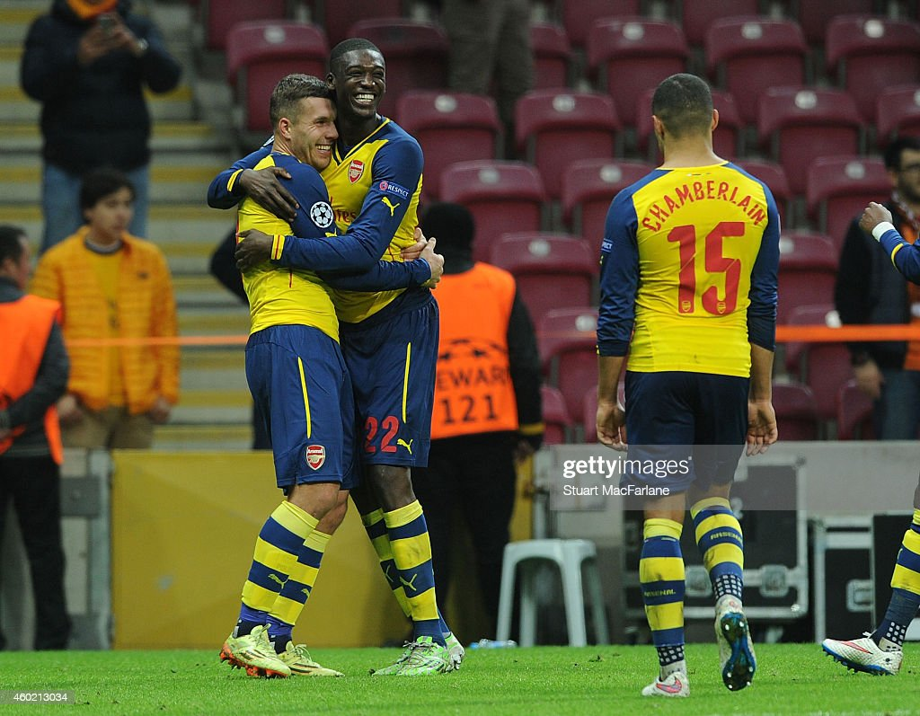 Lukas Podoslki (L) celebrates scoring the fourth Arsenal goal with (2ndL) Yaya Sanogo and (R) Alex Oxlade-Chamberlain during the UEFA Champions League match between Galatasaray and Arsenal at the Turk Telekom Arena on December 9, 2014 in Istanbul, Turkey.
