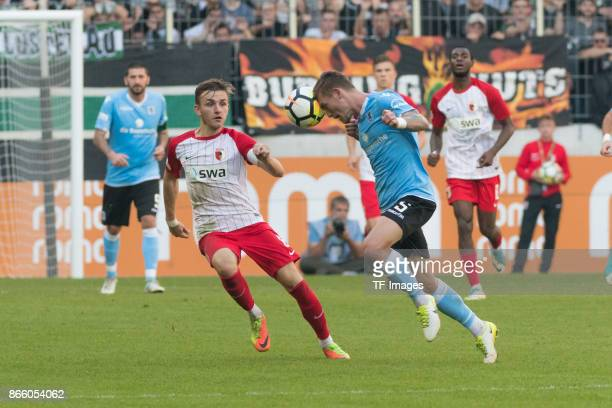Lukas Ramser of Augsburg and Nicolas Andermatt of 1860 Muenchen battle for the ball during the Regionalliga Bayern match between FC Augsburg II and...