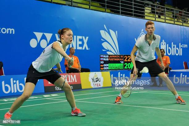 Lukas Resch and Emma Moszczynski of Germany compete against Mikhail Lavrikov and Anastasiia Pustinkaia of Russia during Mixed Double qualification...