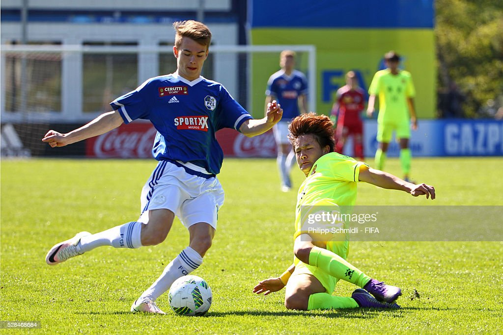 Lukas Riedmann of FC Luzern (L) competes for the ball with Xiaotian Wu of Guangzhou F.C. during the FIFA Blue Stars 2016/FIFA Youth Cup on May 5, 2016 in Zurich, Switzerland.