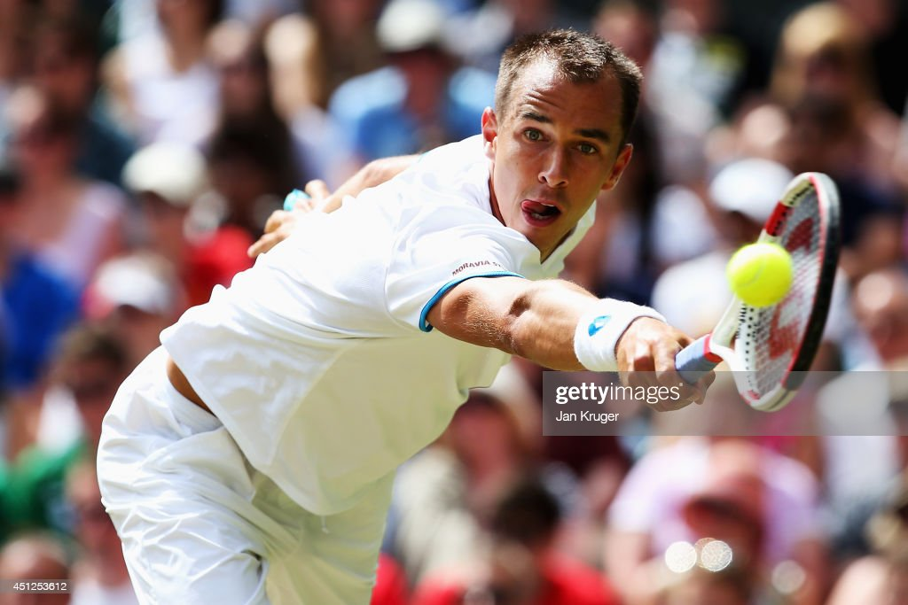 <a gi-track='captionPersonalityLinkClicked' href=/galleries/search?phrase=Lukas+Rosol&family=editorial&specificpeople=4100845 ng-click='$event.stopPropagation()'>Lukas Rosol</a> of Czech Republic in action during his Gentlemen's Singles second round match against Rafael Nadal of Spain on day four of the Wimbledon Lawn Tennis Championships at the All England Lawn Tennis and Croquet Club at Wimbledon on June 26, 2014 in London, England.