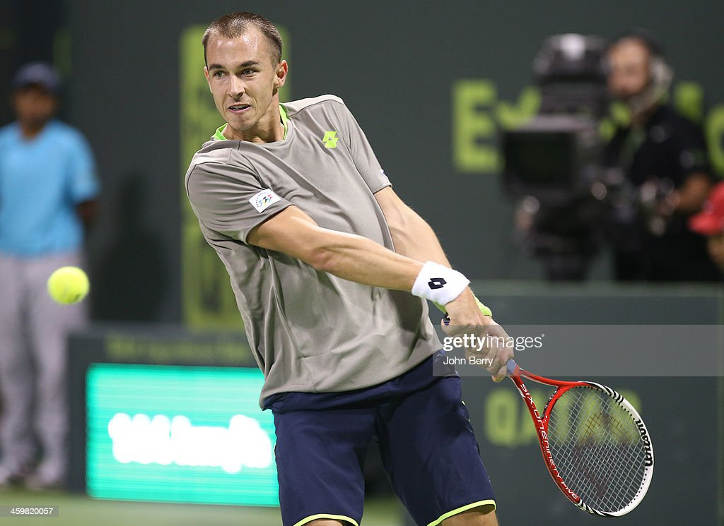Lukas Rosol of Czech Republic in action in his first round match against Rafael Nadal of Spain during the Qatar ExxonMobil Open 2014 held at the...