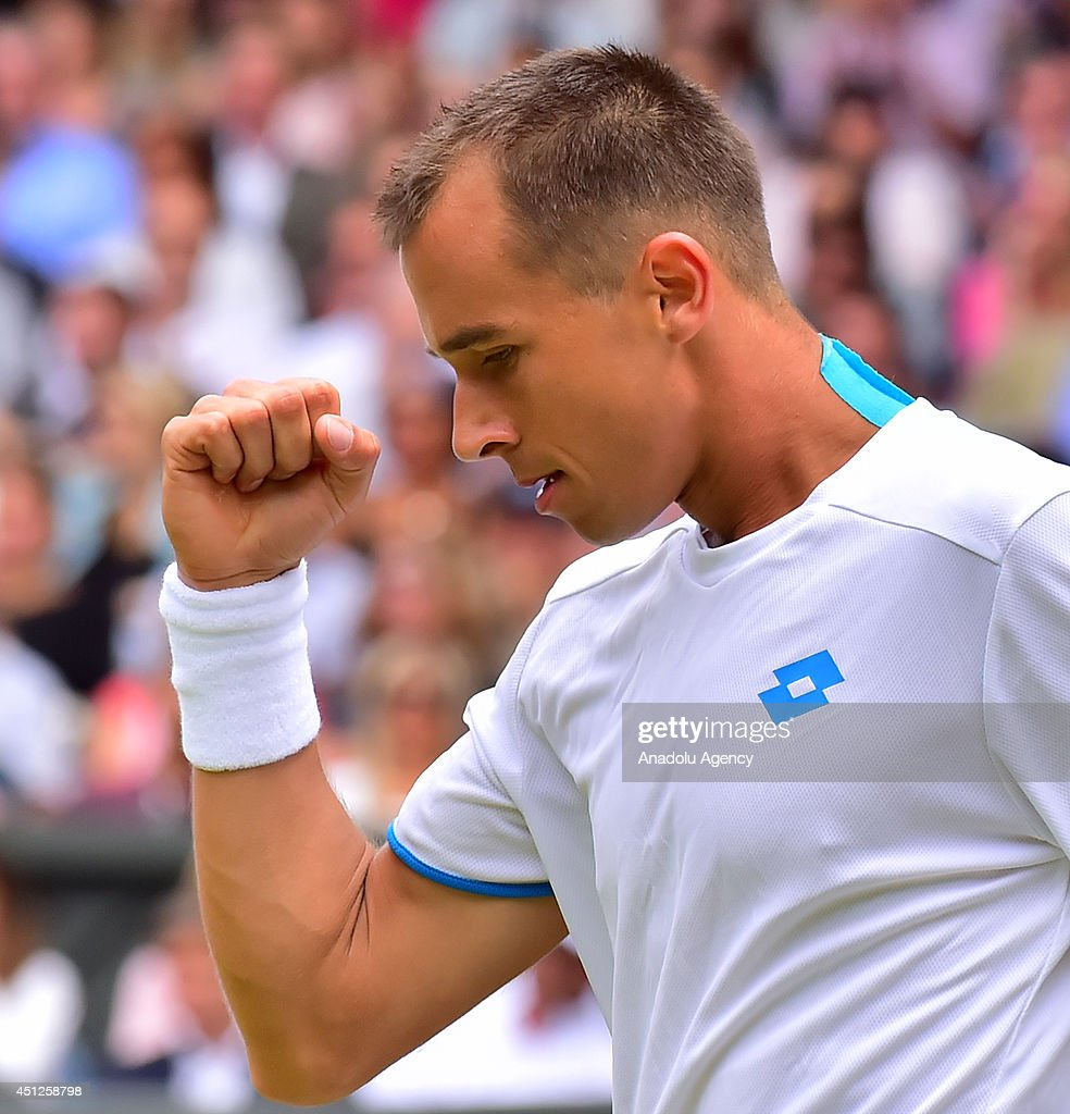 <a gi-track='captionPersonalityLinkClicked' href=/galleries/search?phrase=Lukas+Rosol&family=editorial&specificpeople=4100845 ng-click='$event.stopPropagation()'>Lukas Rosol</a> of Czech Republic reacts during his men's singles second round match against Rafael Nadal of Spain on day four of the 2014 Wimbledon Championships at the All England Tennis and Croquet Club at Wimbledon in London, England on June 26, 2014.