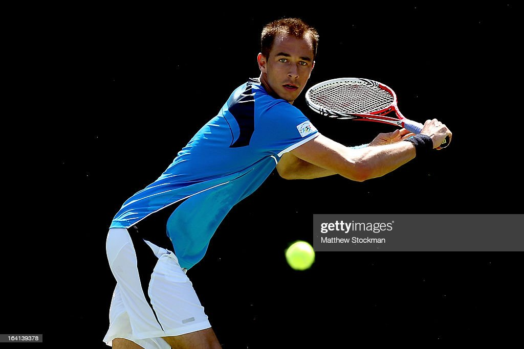 Lukas Rosol of Czech Republic returns a shot to Gilles Muller of Luxembourg during the Sony Open at Crandon Park Tennis Center on March 20, 2013 in Key Biscayne, Florida.