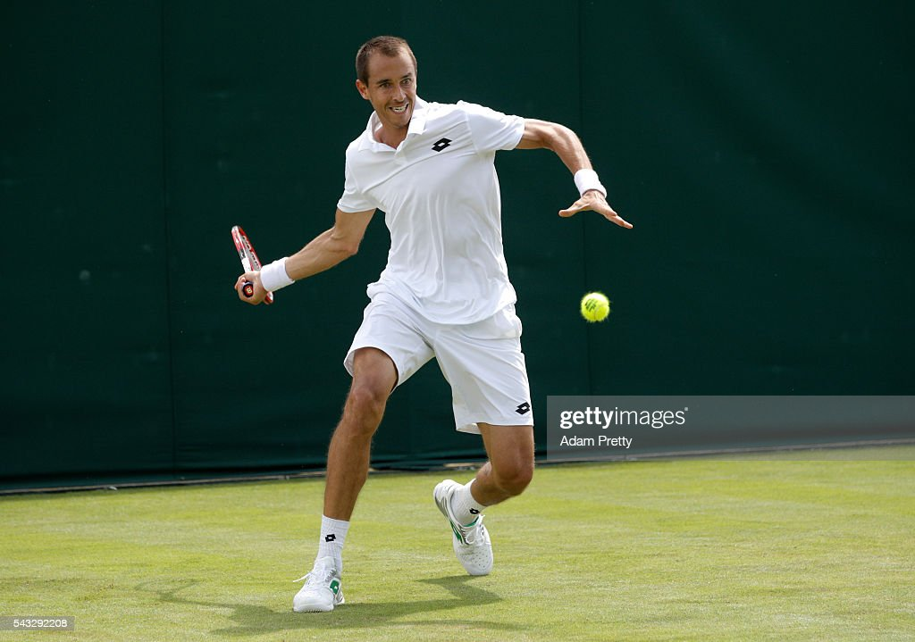 <a gi-track='captionPersonalityLinkClicked' href=/galleries/search?phrase=Lukas+Rosol&family=editorial&specificpeople=4100845 ng-click='$event.stopPropagation()'>Lukas Rosol</a> of The Czech republic plays a forehand shot during the Men's Singles first round match against Sam Querrey of The United States on day one of the Wimbledon Lawn Tennis Championships at the All England Lawn Tennis and Croquet Club on June 27th, 2016 in London, England.