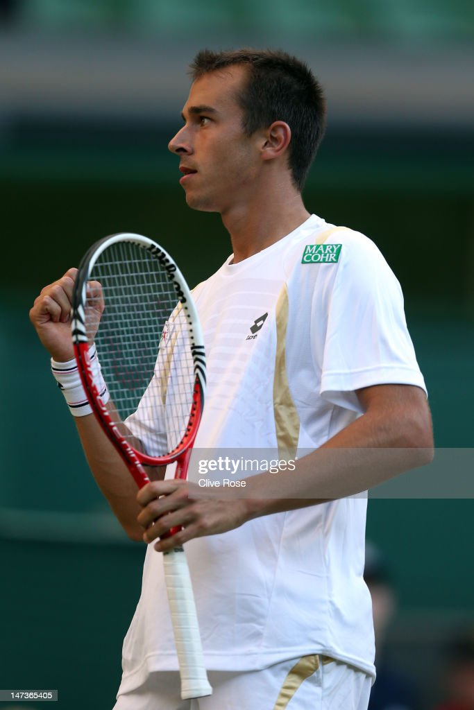 <a gi-track='captionPersonalityLinkClicked' href=/galleries/search?phrase=Lukas+Rosol&family=editorial&specificpeople=4100845 ng-click='$event.stopPropagation()'>Lukas Rosol</a> of the Czech Republic returns a shot during his Gentlemen's Singles second round match against Rafael Nadal of Spain on day four of the Wimbledon Lawn Tennis Championships at the All England Lawn Tennis and Croquet Club on June 28, 2012 in London, England.