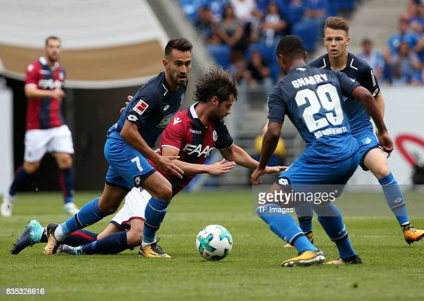 Lukas Rupp of Hoffenheim and Andrea Poli of Bologna and Serge Gnabry of Hoffenheim battle for the ball during the preseason friendly match between...