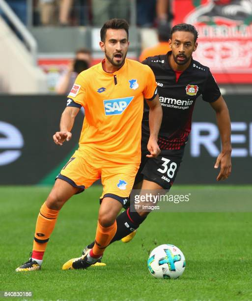 Lukas Rupp of Hoffenheim and Karim Bellarabi of Leverkusen battle for the ball during the Bundesliga match between Bayer 04 Leverkusen and TSG 1899...