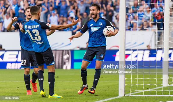 Lukas Rupp of Hoffenheim celebrates the second goal for his team wuth Kerem Demirbay of Hoffenheim and Andrej Kramaric of Hoffenheim during the...