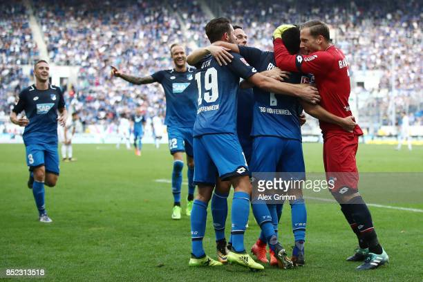 Lukas Rupp of Hoffenheim celebrates with team mates after he scored his teams second goal to make it 20 during the Bundesliga match between TSG 1899...
