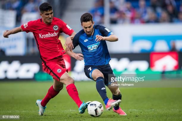 Lukas Rupp of Hoffenheim is challenged by Aymane Barkok of Frankfurt during the Bundesliga match between TSG 1899 Hoffenheim and Eintracht Frankfurt...