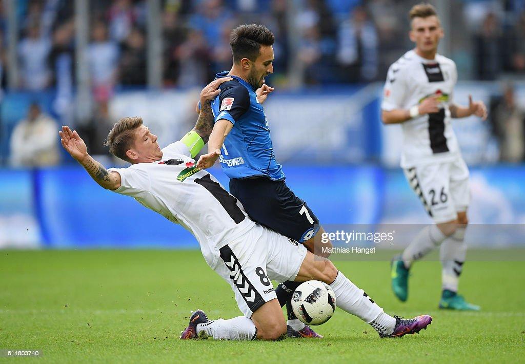 Lukas Rupp of Hoffenheim is challenged by Mike Frantz of Freiburg during the Bundesliga match between TSG 1899 Hoffenheim and SC Freiburg at Wirsol Rhein-Neckar-Arena on October 15, 2016 in Sinsheim, Germany.