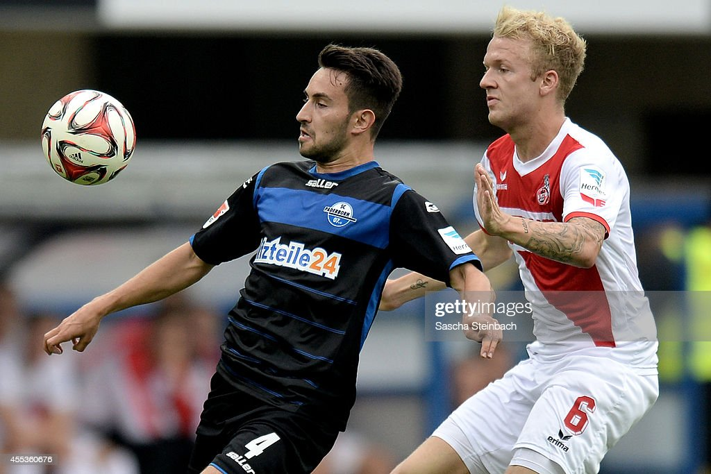 Lukas Rupp of Paderborn vies with Kevin Voigt of Koeln during the Bundesliga match between SC Paderborn 07 and 1 FC Koeln at Benteler Arena on...
