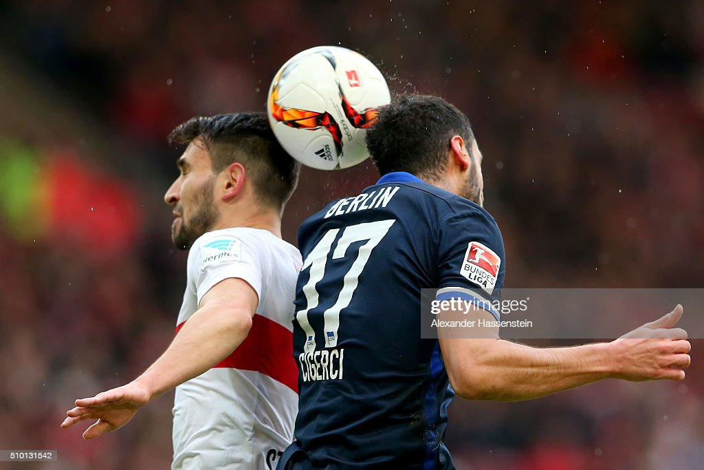 Lukas Rupp of Stuttgart battles for the ball with Tolga Cigerci (R) of Hertha during the Bundesliga match between VfB Stuttgart and Hertha BSC Berlin at Mercedes-Benz Arena on February 13, 2016 in Stuttgart, Germany.