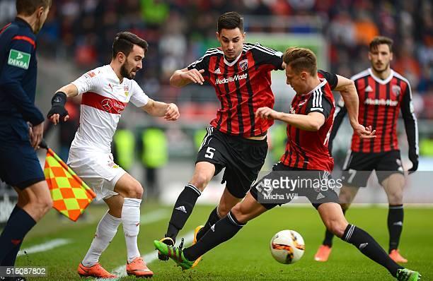 Lukas Rupp of Stuttgart Benjamin Huebner of Ingolstadt and Robert Bauer of Ingolstadt compete for the ball during the Bundesliga match between FC...