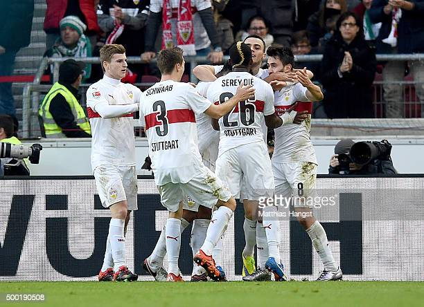 Lukas Rupp of Stuttgart celebrates with his teammates after scoring his team's first goal during the Bundesliga match between VfB Stuttgart and...