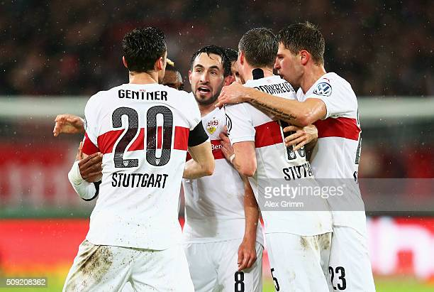 Lukas Rupp of Stuttgart celebrates with team mates as he scores their first and equalising goal during the DFB Cup Quarter Final match between VfB...