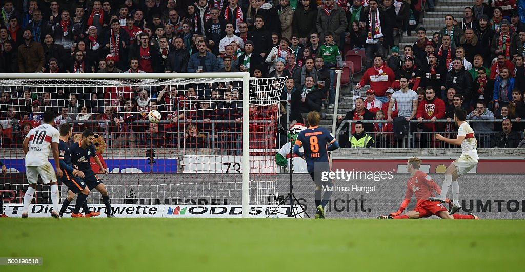 Lukas Rupp of Stuttgart scores his team's first goal past goalkeeper Felix Wiedwald of Bremen during the Bundesliga match between VfB Stuttgart and...