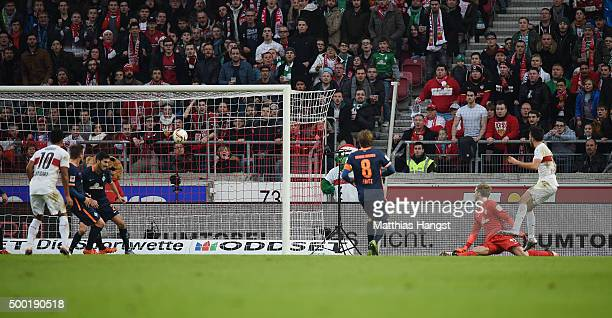 Lukas Rupp of Stuttgart scores his team's first goal past goalkeeper Felix Wiedwald of Bremen during the Bundesliga match between VfB Stuttgart and...
