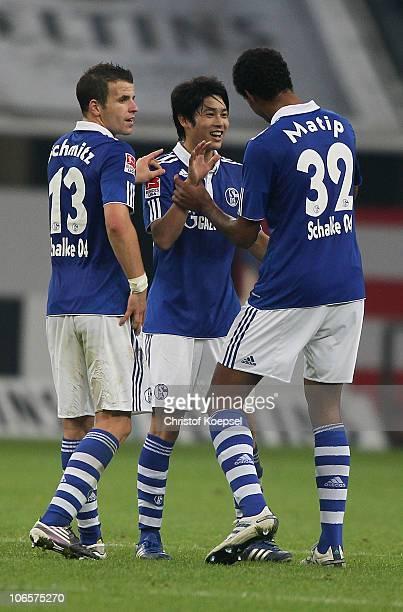 Lukas Schmitz Atsuto Uchida of Schalke and Joel Matip celebrate the 30 victory after the Bundesliga match between FC Schalke 04 and FC St Pauli at...