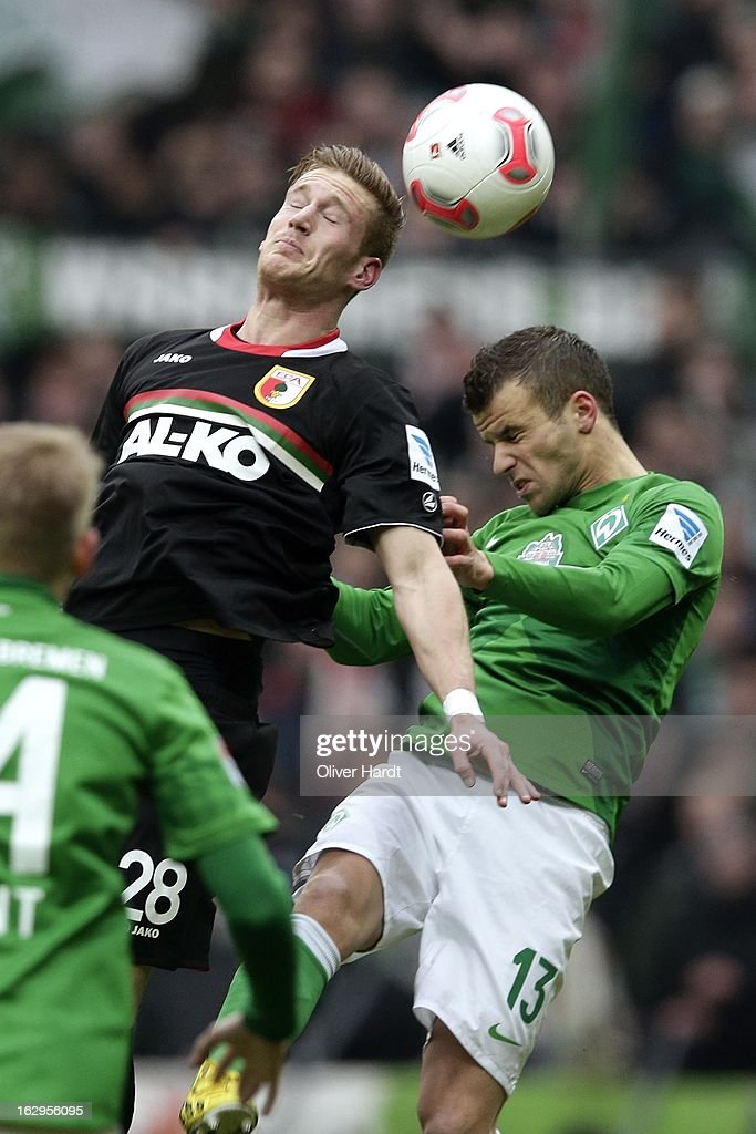 Lukas Schmitz (R) of Bremen and Andre Hahn (L) of Augsburg battle for the ball during the Bundesliga match between SV Werder Bremen and FC Augsburg at Weser Stadium on March 2, 2013 in Bremen, Germany.