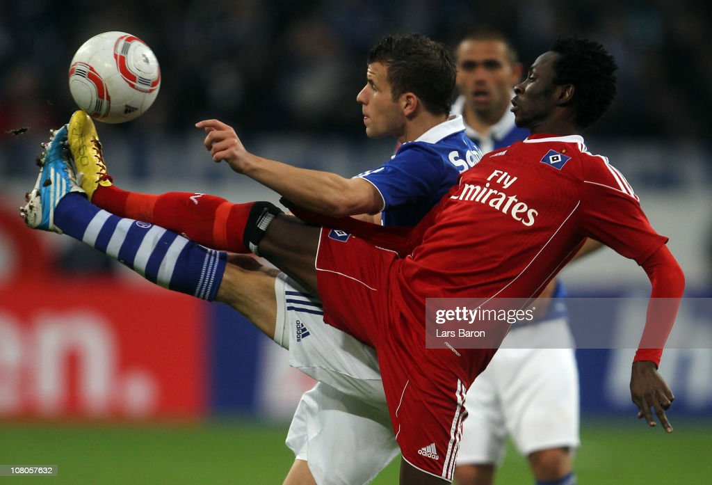 <a gi-track='captionPersonalityLinkClicked' href=/galleries/search?phrase=Lukas+Schmitz&family=editorial&specificpeople=6269299 ng-click='$event.stopPropagation()'>Lukas Schmitz</a> of Schalke is challenged by <a gi-track='captionPersonalityLinkClicked' href=/galleries/search?phrase=Jonathan+Pitroipa&family=editorial&specificpeople=685230 ng-click='$event.stopPropagation()'>Jonathan Pitroipa</a> of Hamburg during the Bundesliga match between FC Schalke 04 and Hamburger SV at Veltins Arena on January 15, 2011 in Gelsenkirchen, Germany.