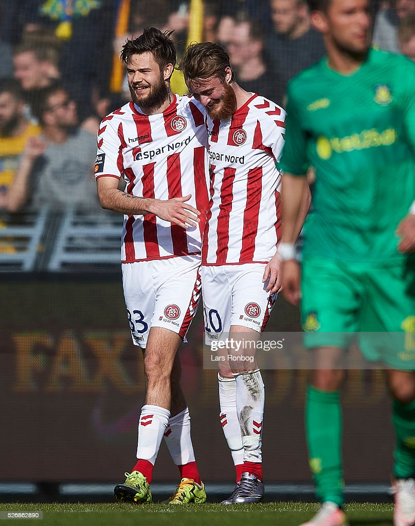 Lukas Spalvis and Rasmus Jonsson of AaB Aalborg celebrate after scoring their second goal during the Danish Alka Superliga match between AaB Aalborg and Brondby IF at Nordjyske Arena on May 1, 2016 in Aalborg, Denmark.