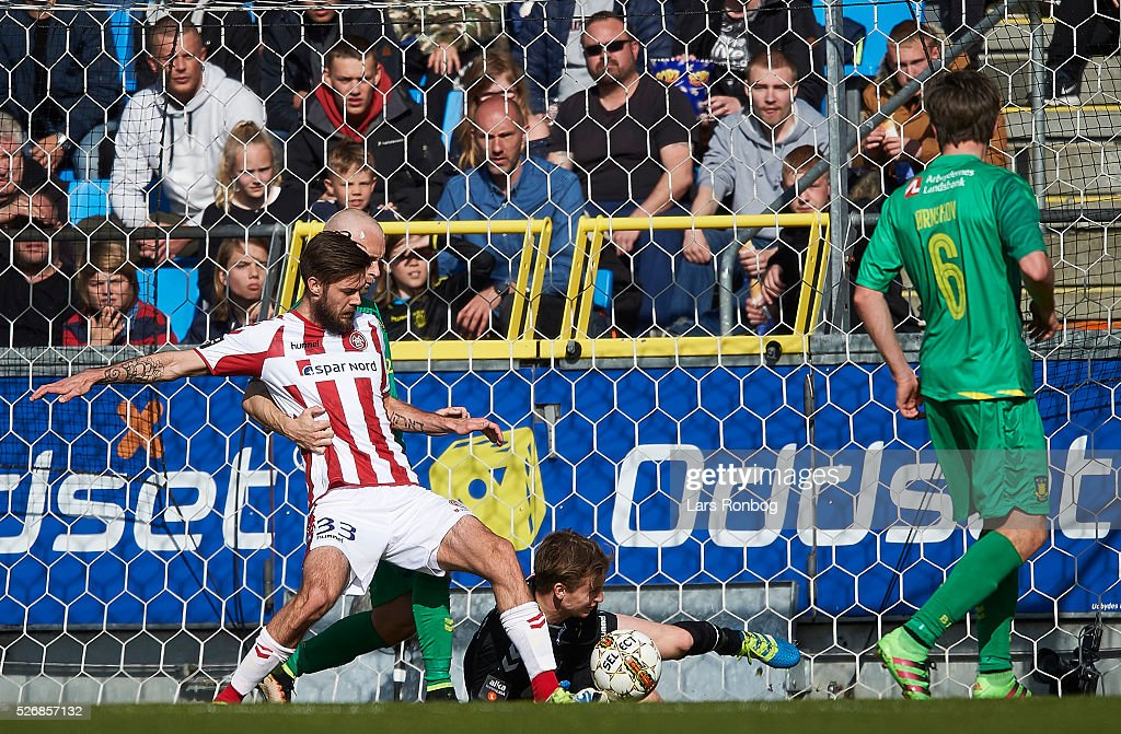 Lukas Spalvis of AaB Aalborg scores the 2-0 goal against Goalkeeper Frederik Ronnow of Brondby IF during the Danish Alka Superliga match between AaB Aalborg and Brondby IF at Nordjyske Arena on May 1, 2016 in Aalborg, Denmark.