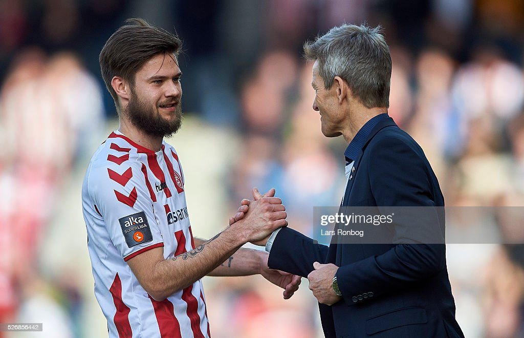 Lukas Spalvis of AaB Aalborg shake hands with Lars Sondergaard, head coach of AaB Aalborg during the Danish Alka Superliga match between AaB Aalborg and Brondby IF at Nordjyske Arena on May 1, 2016 in Aalborg, Denmark.