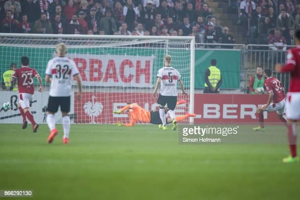 Lukas Spalvis of Kaiserslautern scores his team's first goal past goalkeeper RonRobert Zieler of Stuttgart during the DFB Cup match between 1 FC...
