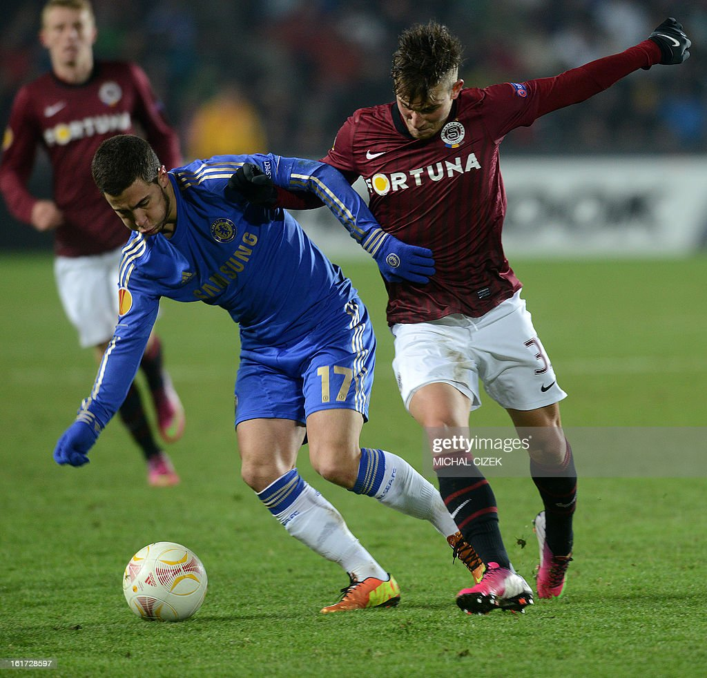 Lukas Vacha of Sparta Praha (R) vies for a ball with Eden Hazard of Chelsea FC during the UEFA Europa League football match AC Sparta Praha vs Chelsea FC on February 14, 2013 in Prague, Czech Republic.