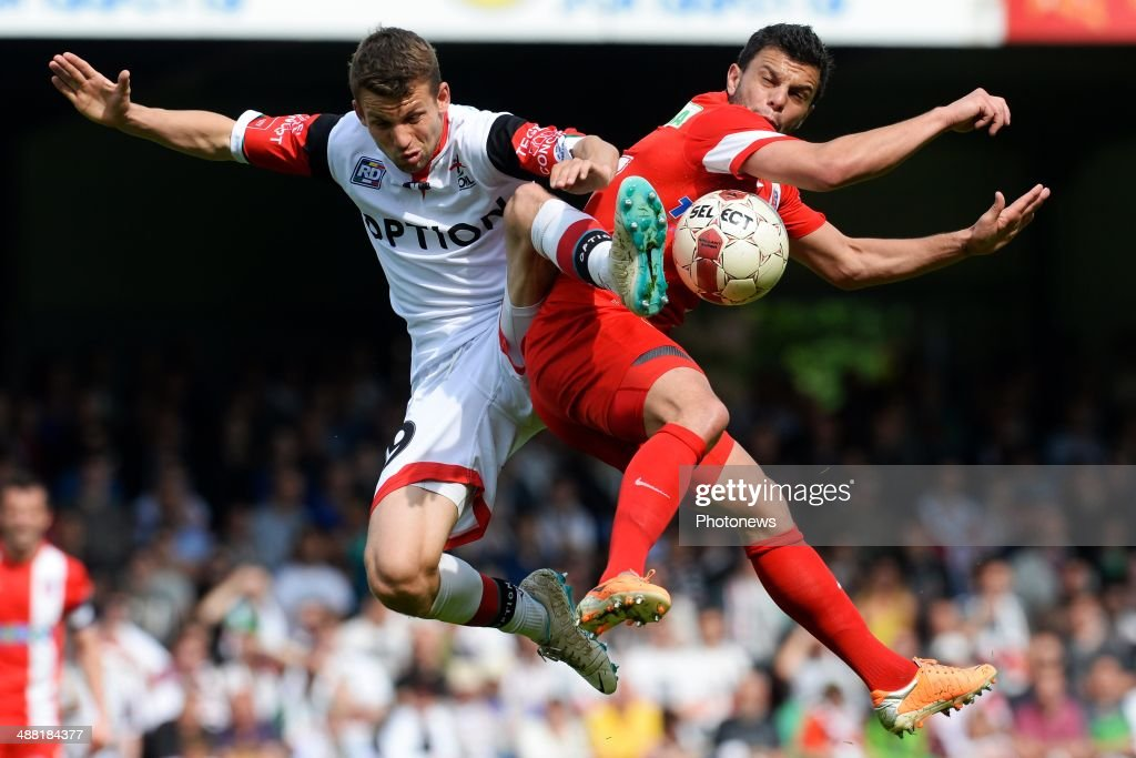 Lukas Van Eenoo of OH Leuven battles for the ball with Sebastien Pennacchio of Mouscron during match day 1 of the Final Round in the second division match between Oud Heverlee Leuven and Royal Mouscron Peruwelz on May 4, 2014 in Leuven, Belgium.