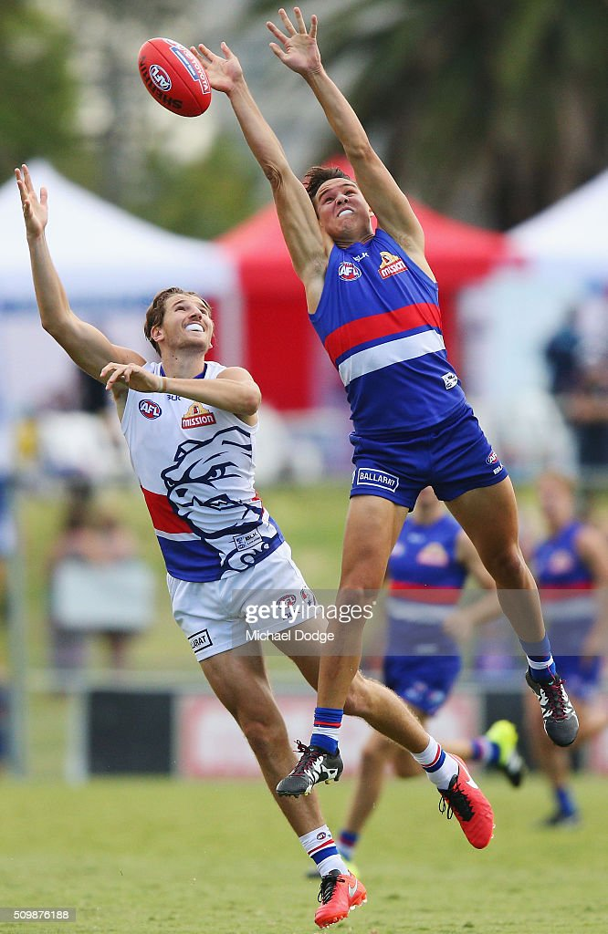Lukas Webb of the Bulldogs (R) and Marcus Bontempelli of the Bulldogs compete for the ball during the Western Bulldogs AFL intra-club match at Whitten Oval on February 13, 2016 in Melbourne, Australia.