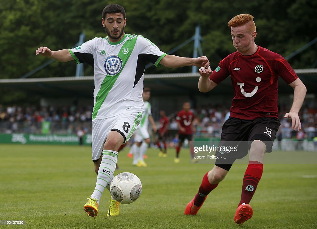Lukas Wilton (R) of Hannover and Tolcay Cigerci of Wolfsburg compete for the ball during the A Juniors Bundesliga Semi Final at Beekestadium on June 11, 2014 in Hanover, Germany.