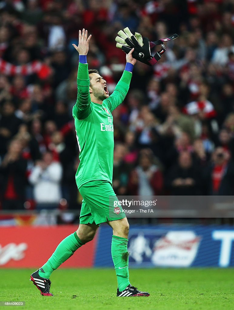 Lukasz Fabianski of Arsenal celebrates after winning the penalty shoot-out to claim victory in the FA Cup Semi-Final match between Wigan Athletic and Arsenal at Wembley Stadium on April 12, 2014 in London, England.