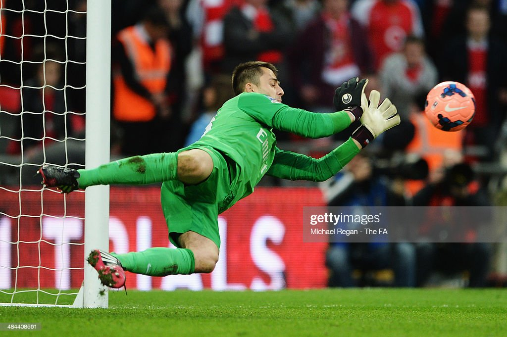 Lukasz Fabianski of Arsenal saves a penalty from Jack Collison of Wigan Athletic during the FA Cup Semi-Final match between Wigan Athletic and Arsenal at Wembley Stadium on April 12, 2014 in London, England.