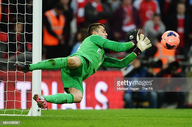Lukasz Fabianski of Arsenal saves a penalty from Jack Collison of Wigan Athletic during the FA Cup SemiFinal match between Wigan Athletic and Arsenal...