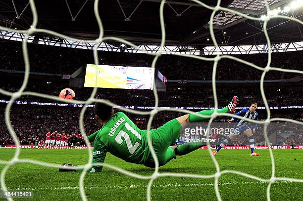Lukasz Fabianski of Arsenal saves Jack Collison of Wigan Athletic's penalty during the shoot out during the FA Cup SemiFinal match between Wigan...