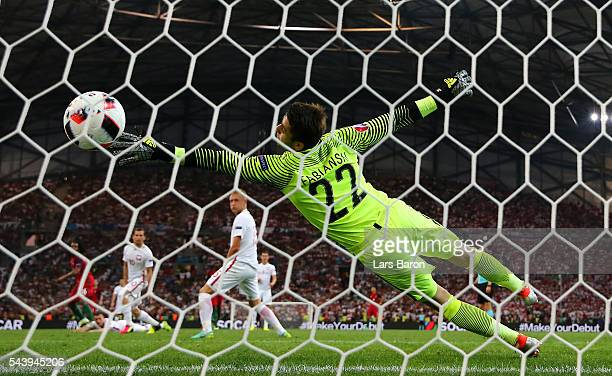 Lukasz Fabianski of Poland dives in vain as Renato Sanches of Portugal scores his team's first goal during the UEFA EURO 2016 quarter final match...