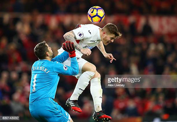 Lukasz Fabianski of Swansea City clashes with Alfie Mawson of Swansea City during the Premier League match between Middlesbrough and Swansea City at...