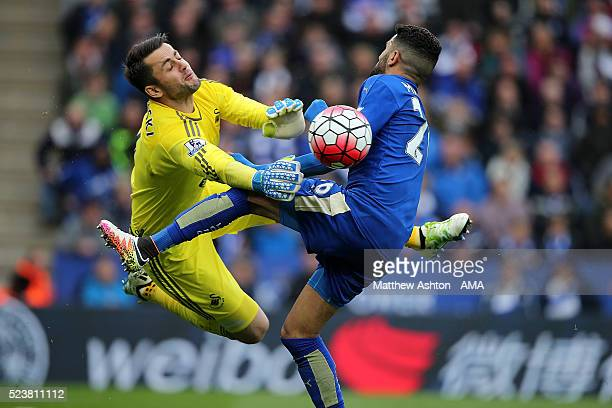 Lukasz Fabianski of Swansea City collides with Riyad Mahrez of Leicester City during the Barclays Premier League match between Leicester City and...