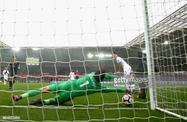 Lukasz Fabianski of Swansea City makes a save from Wilfred Ndidi of Leicester City during the Premier League match between Swansea City and Leicester...