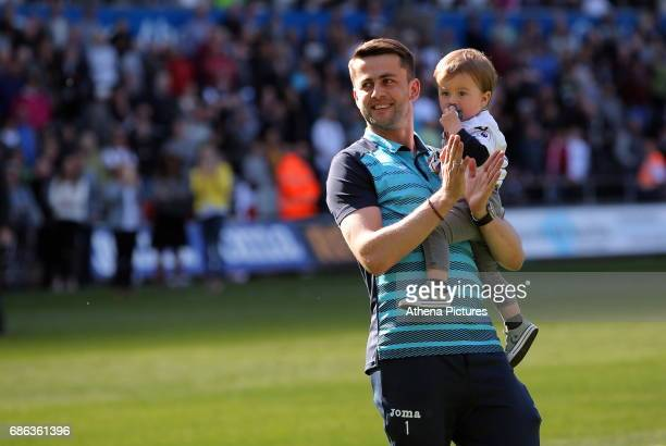 Lukasz Fabianski of Swansea City with his baby thanks home supporters after the Premier League match between Swansea City and West Bromwich Albion at...