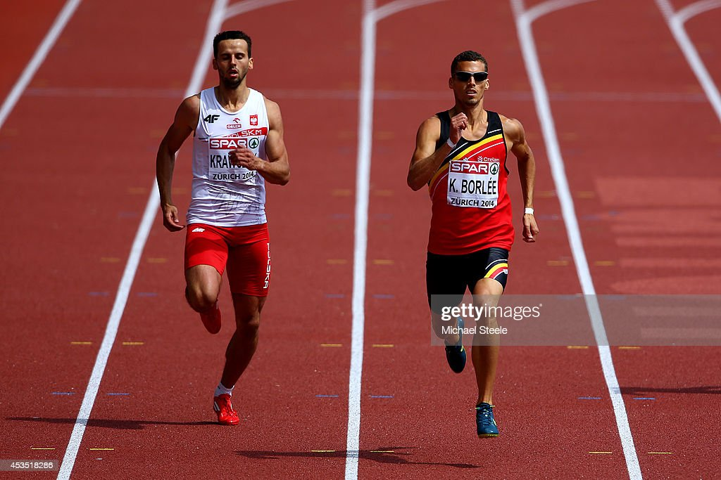 Lukasz Krawczuk of Poland and Kevin Borlee of Belgium compete in the Men's 400 metres heats during day one of the 22nd European Athletics Championships at Stadium Letzigrund on August 12, 2014 in Zurich, Switzerland.