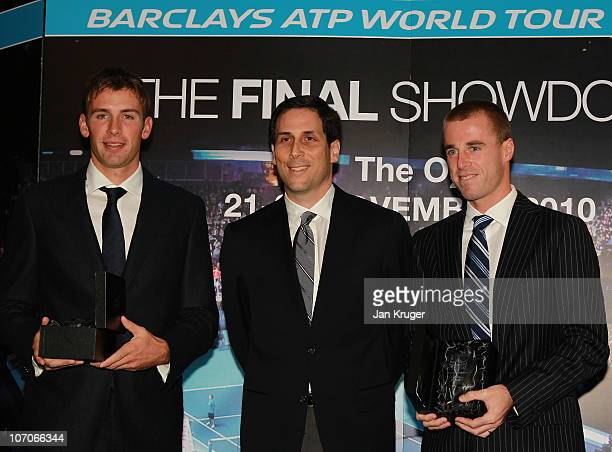 Lukasz Kubot and Oliver Marach receive their trophies from CEO of the ATP Adam Helfant during the Barclays ATP World Tour Finals Media Day at the...