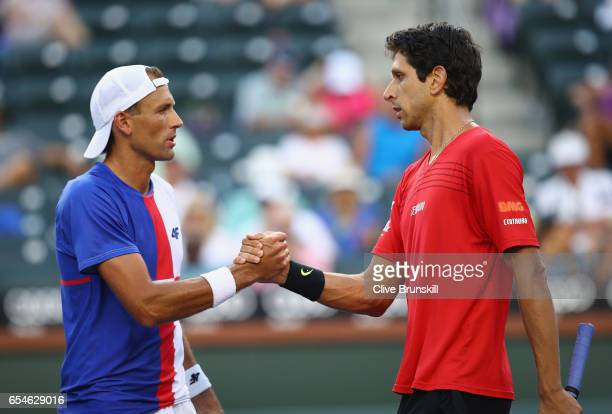 Lukasz Kubot of Poland and his partner Marcelo Melo of Brazil celebrate their three set victory against Bruno Soares of Brazil and Jamie Murray of...