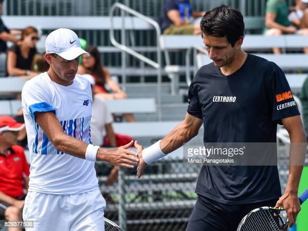 Lukasz Kubot of Poland and Marcelo Melo of Brazil encourage one another in their doubles match against Fabrice Martin and Edouard Rogervasselin of...