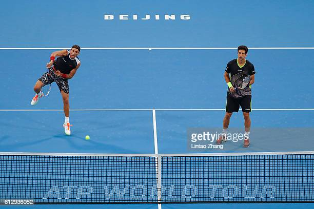 Lukasz Kubot of Poland and Marcelo Melo of Brazil in action against Edouard RogerVasselin and Julien Benneteau of France during their Men's doubles...