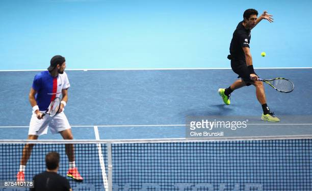 Lukasz Kubot of Poland and Marcelo Melo of Brazil in action in the Doubles match against Jamie Murray of Great Britain and Bruno Soares of Brazil...
