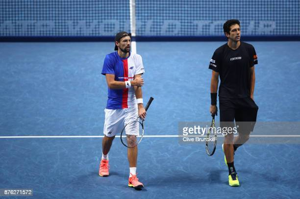 Lukasz Kubot of Poland and Marcelo Melo of Brazil in conversation during the doubles final against John Peers of Australia and Henri Kontinen of...